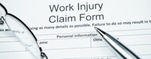 work injury clam form being filled out