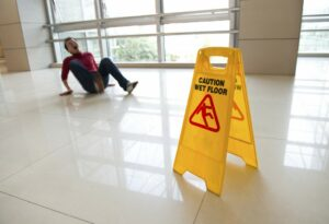 man on floor from slip and fall injury